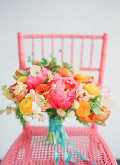 Bright pink and orange parrot tulip bridal bouquet for a spring wedding.