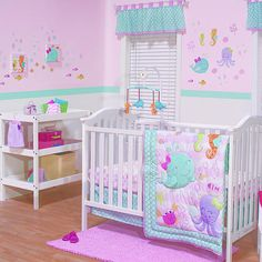 This sweet collection will create a lovely nursery for your little mermaid. The collection brings a pretty pink and aqua color story together with accents of raspberry, lavender, orange and green.<br><br>The Belle Sea Sweetie 3 Piece Crib Bedding Set Features:<br><ul><li>Comforter: 65% polyester/35 cotton with 100% polyester fill.</li><br><li>Sheet: 100% cotton.</li><br><li>Bed skirt Drop: 65% polyester/35% ...