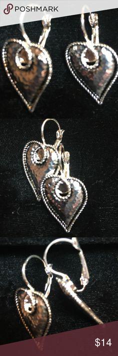 """Hammered Heart Pierced Earrings  silver tone Hammered Heart Pierced Earrings silver tone. Never been worn.    Approximately 3/4"""" wide x 1"""" tall Jewelry Earrings"""