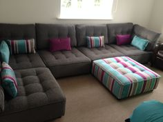 Here's a good example of plain grey ooomphed up with a splash of colour!