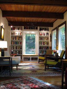 bookshelves around window, seating with storage beneath, ceiling detail