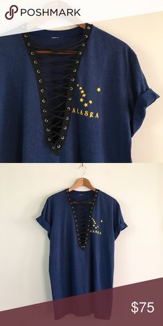 80s / Oversized Alaska Tee Soft & thin oversized tee with gold Alaska constellation graphic and black lacing down the center. Can be worn as a t-shirt dress depending on your height. One of a kind!  BRAND: - MATERIAL: 50/50 YEAR/ERA: 80s LABEL SIZE: - BEST FIT: S/M/L  MEASUREMENTS: Chest 23 inches Length 30 inches  *Listed as LF for views. *Price firm unless bundled.  🚫 I do not model or trade, sorry! 💟 Check out my closet for more vintage!     0057 LF Tops Tees - Short Sleeve