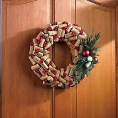 Deck the halls with corks and holly! This may be the most talked-about decoration of the season. More than 70 wine corks are fastened to a bamboo base garnished with faux holly berries and enlivened b.