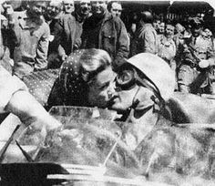 de Portago kisses his fiancé Linda Christian as he passes through Rome during the 1957 Mille Miglia. Hours later he was killed.
