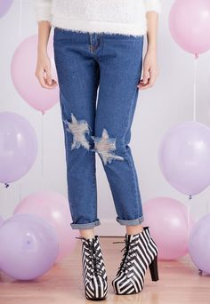 * Distressed boyfriend jeans featuring shredded stars detailing and cutouts at knees