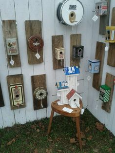 Bird houses made from a piece of wood old tins and screws or nails for perch