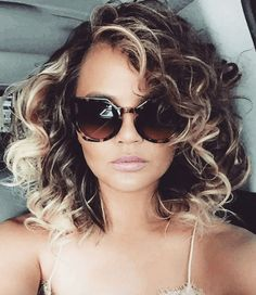 Chrissy Teigen's cute curls prove that 1980s hairstyles are definitely having a moment. Learn how to get her look with our step-by-step guide, now. | All Things Hair - From hair experts at Unilever