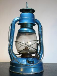 vintage enameled blue kerosene dietz ny little wizard railroad lantern oil lamp - i saw a photo once where someone hung 2-4 lanterns above their dining room table as lighting. amazing vintage-industrial look (still use with kerosene vs. electric so it's constantly functioning).