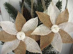 """Burlap poinsettia ornaments. DIY...They have a touch of clear glitter to add some sparkle and a vintage button for the center. They hang from an organdy ribbon and are finished on the back with a round of felt. They measure 5.5"""" across"""