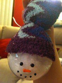 Homemade Snowmen Christmas ornaments - filled with Buffalo snow, painted with puffy paint, hats made out of cut home socks tied with ribbon