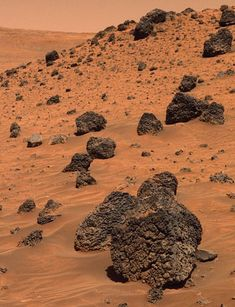 True color image of volcanic basalt rocks in the Gusev Crater, Mars.