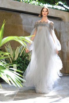 A pale grey wedding dress glows at sophisticates