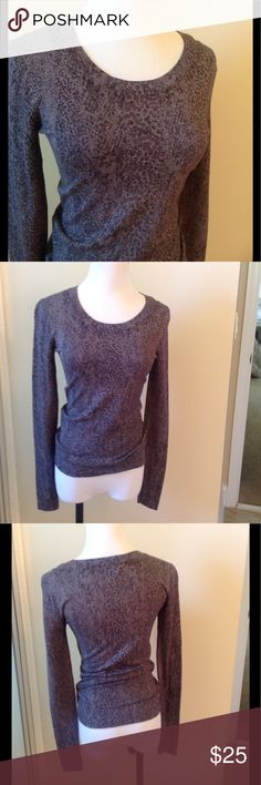 Diane Von Furstenberg Top Diane Von Furstenberg long sleeve top. In new condition. Grey with metallic fibers for a slightly shimmery look. Tagged a P for x small, fits a 0-2 best. Diane von Furstenberg Tops