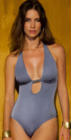 Sav 2013 Slate Blue One Piece Swimsuit Brazilian Cut 1512109 The Sav 2013 slate blue bathing suit is a sexy swimsuit has a plunging neckline and is accented with a gold hardware detail at the center. The Sav blue swimsuit offers removable soft cups and ties at the back. The back of this swimsuit cuts straight acros