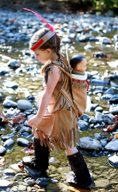 Hand made Halloween Indian inspired Girl costume made in faux suede fabric with beads and faux fur accents.High quality made to last for years of fun