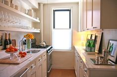 Open shelving makes space larger in galley kitchens.