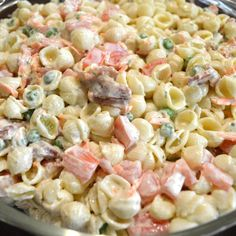 Homemade Bacon Ranch Pasta Salad16 oz shell macaroni, small bag of frozen peas 2 Roma tomatoes diced 1 cucumber diced 1/2 cup grated cheese 1 package of dry  ranch dressing mix 3/4 to 1 cup Mayonnaise In a medium bowl with a lid, add the Mayo and Ranch dressing together first. Mix well, then add the rest of the ingredients together. Add more Mayo if you like moister salad. Let sit in fridge for an hour with lid on tight before serving!