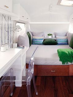 Comfy bed, beautiful colors, and nice setup overall for RV interior