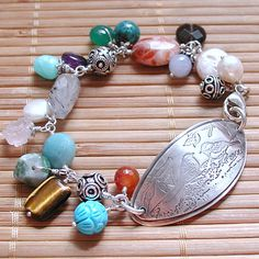 Colorful Amazing Semi Precious Dangle bracelet with huge Sterling plaque With Bird Etching. $165.00, via Etsy.