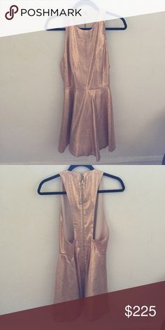 Alice + Olivia Rose Gold Cocktail dress NWT! Gorgeous shimmering rose gold racer back Alice + Olivia mini. Perfect for a Holiday or NYE party! Alice + Olivia Dresses Mini