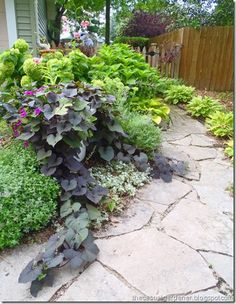 Use all the flagstone from previous owners to line new flower gardens...yes I like.
