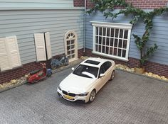 BMW 3 series with custom M-performance bumpers. Mods by www.modelcarworkshop.nl. Base model 1:18 by Norev,