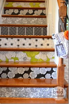 love this wallpapered stairs idea!