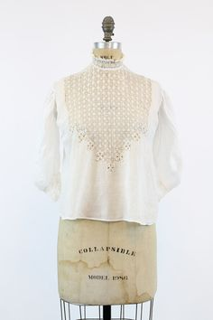 Gorgeous Edwardian blouse! Done in a white cotton with intricate lace cut out detailing! The lace makes up the front, shoulders and back of blouse.