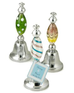"Art Deco Glass Party Bell Favor Size: 4.5""H x 1.75""W Ring in the festivities with our fun and festive Art Deco Glass Bell Favor. This beautiful functional silver bell is topped with a delightful finial crafted of glass in assorted styles and colors. The top and bottom of the finial handle are adorned with a silver bell. Pick from several tag colors to make this item truly spectacular. Set the stage for good times with our stunning art deco glass bells. Set them out for all of your guests to…"