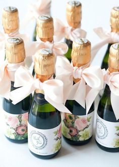 How gorgeous are these mini champagne wedding favors? perfect for a classic, elegant wedding reception or bridal shower. add a label of your choice to make Wedding Favors And Gifts, Champagne Wedding Favors, Mini Champagne Bottles, Creative Wedding Favors, Mini Bottles, Wedding Guest Favors, Champagne Party, Party Favours, Olive Oil Wedding Favors