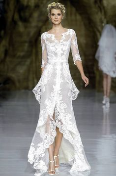 I dare you! The perfect lace dress for those who can pull it off. Pronovias.