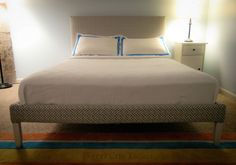 Upholstered Ikea Fjellse bed hack- @Lorrie Cerny we're doing this ASAP when I'm back for the summer! I love it!