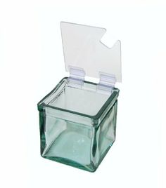 """Cal-Mil 1811-N Notched Soft Hinge Jar Lid by CAL-MIL. $8.56. Add this lid to any of Cal-Mil's 4""""x4"""" glass jars for your serving needs. Keep food fresh and safe from contaminants. Great for bars, yogurt and ice cream stations, and any condiment needs. The soft plastic hinge allows easy application or removal. The notched lid works great for spoons and is also available in a solid configuration (Cal-Mil 1811), or with a metal hinge for durability (Cal-Mil 1807-N)."""