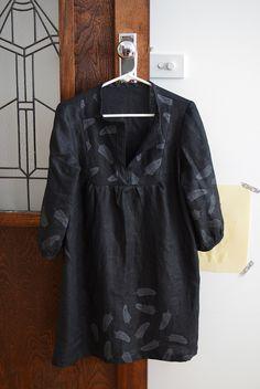 in handprinted black linen