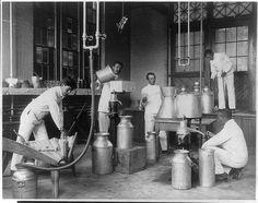 Five men making butter in a class @ Hampton Institute, VA circa 1900