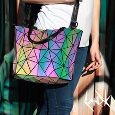 A fun and stylish, star pattern holographic handbag that changes color when it reflects light - price increases with every purchase - grab yours today!