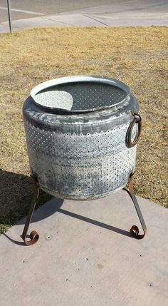 Old washer tub converted to a fire pit and used as a table (add a top).