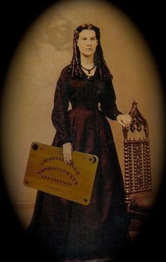 Spooky  http://mysticcuriogiftshop.files.wordpress.com/2012/02/woman-wtth-board.jpg