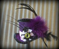 Hey, I found this really awesome Etsy listing at http://www.etsy.com/listing/123473148/cheshire-cat-mini-top-hat-tea-party-mini