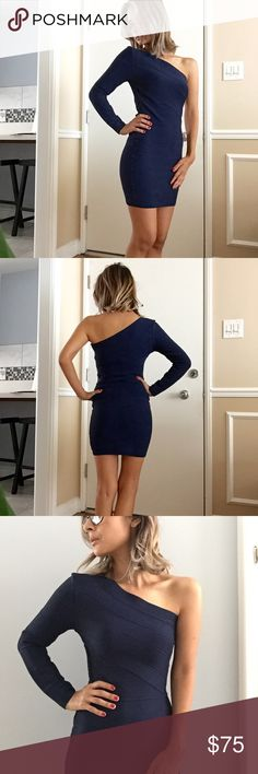 Guess by Marciano navy blue bandage dress Guess by Marciano navy blue bandage dress. One shoulder, long sleeved mini dress. Side zipper, thick material gives this a sexy fitted look! I'm so sad this one doesn't fit me. My loss, your gain! Marciano Dresses Mini