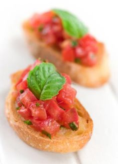 Bruschetta with Tomato and Basil  Gina's Weight Watcher Recipes  Servings: 26 • Size: 1 slice bread with tomatoes • Old Points: 1 pt • Points+: 1 pt   Calories: 49.6 • Fat: 0.6 g • Carb: 9.1 g • Fiber: 0.5 g • Protein: 1.1 g • Sugar: 0.2  Sodium: 2 mg (without salt)