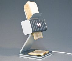 """This toaster operates like a desktop ink-jet printer because it """"prints out"""" your bread slices as it toasts them."""