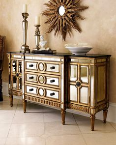 """Mirrored Console Hardwood frame, granite top, and beveled-mirror veneers. Golden finish on frame. Three drawers, two doors, and two shelves. 70""""W x 20""""D x 38""""T. Imported. Boxed weight, approximately 376 lbs. Mirrored Console Compare At: $2,182.00 Special Value: $1,849.00"""