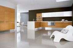 white ceramic kitchen floors - Google Search ****LIke idea of extending countertop down to the floor by sliding glass door, will give some separation of woods (cabinet/drawers vs. living room wood floors)