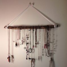 Necklace hanger I made (: from ribbon and a stick!
