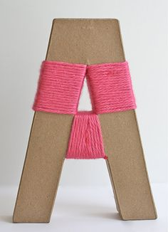it would be so cute to wrap the letters of a kiddos name in yarn, and hang it on a nursery wall..