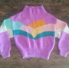 "✨ Vintage 70s 80s Sweater ❤ Ski bunny cuteness vintage pullover sweater Unique cut, bright colors. Estimated fit s/m for baggy fit. Shown on 5'8"" size small Armpit 38"" waist 25-30"" elastic  21"" length It's a little itchy so best layered w a soft shirt. Minor pilling. Some unevenness in the stitching so areas are tight, others more separated and open weave. Good vintage condition. Worn, preowned and loved. Vintage Sweaters"