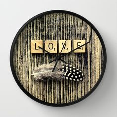 love Wall Clock$30 - free shipping through till sunday #new #awesome #contemporary #wall #clock #ingz #Society6 #photography #cool #abstract #love #feather #wood #valentine #romantic