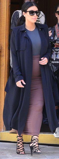 Kim Kardashian West in Yves Saint Laurent sunglasses, a Maison Martin Margiela bodysuit, Wolford dress, and Hermès shoes