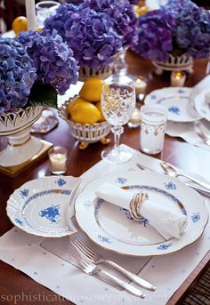 Lovely blue and white table from Sophistication is Overrated by Babs Horner and Susan Palma. Herend's Chinese Bouquet in Blue is absolutely gorgeous paired with purple hydrangea and lemons. LOVE the unexpected color combination.